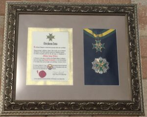 A framed Knight Commander brevet with the neck badge and breast star of our Order